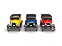 Beautiful 1920s vintage cars in primary colors - studio shot Stock Photos