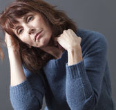 Beautiful 50's woman suffering from winter blues Stock Photo