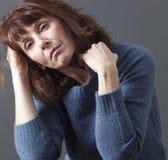 Beautiful 50's woman suffering from winter blues stock photo
