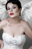 Beautiful sad angel with white corset Royalty Free Stock Photography