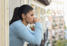 Beautiful sad and desperate hispanic woman suffering depression thoughtful frustrated Stock Photos