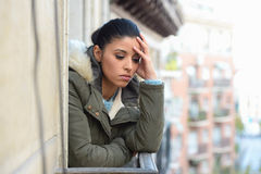 Beautiful sad desperate hispanic woman in winter coat suffering depression Royalty Free Stock Image
