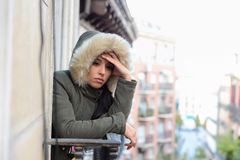 Beautiful sad desperate hispanic woman in winter coat suffering depression Royalty Free Stock Photo