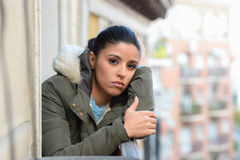 Beautiful sad desperate hispanic woman in winter coat suffering depression. Young beautiful sad and desperate hispanic woman in winter coat suffering depression Stock Photo
