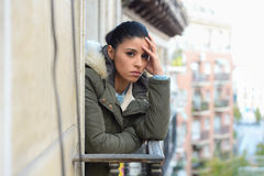 Beautiful sad desperate hispanic woman in winter coat suffering depression. Young beautiful sad and desperate hispanic woman in winter coat suffering depression Royalty Free Stock Photo