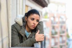 Beautiful sad desperate hispanic woman in winter coat suffering depression Stock Image
