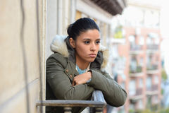 Beautiful sad desperate hispanic woman in winter coat suffering depression Stock Photography