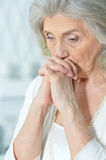 Beautiful sad elderly woman Stock Photos