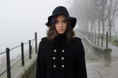Beautiful sad girl in black clothes in autumn Royalty Free Stock Photos