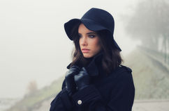 Beautiful sad girl in black clothes, black hat, leather glove Stock Photography