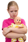 The beautiful sad girl with a doll Royalty Free Stock Photos