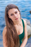Beautiful sad girl with green eyes. Portrait of a beautiful sad girl with green eyes outdoor in summer Stock Photo