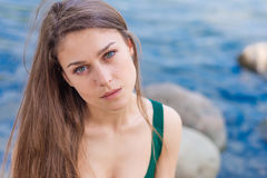 Beautiful sad girl with green eyes. Portrait of a beautiful sad girl with green eyes outdoor in summer Royalty Free Stock Images