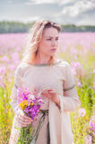 Beautiful sad girl on meadow Stock Photo