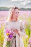 Beautiful sad girl on meadow Stock Photo