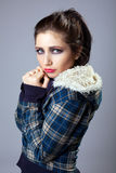 Beautiful sad girl portrait in jeans fur jacket Stock Images