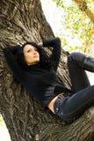 Beautiful sad girl on the tree Royalty Free Stock Image