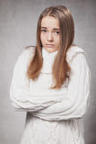 Beautiful sad girl in a white sweater Stock Photo
