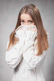 Beautiful sad girl in a white sweater Stock Image