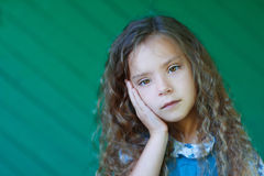 Beautiful sad little girl Stock Images