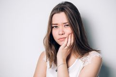 Beautiful sad unhappy woman feel pain on her teeth isolated on white background royalty free stock photos