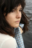 Beautiful sad woman. Portrait of beautiful serious woman with scarf on water background Stock Photography