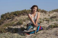 Beautiful sad woman on the beach Stock Image