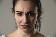 Beautiful and sad woman crying desperate and depressed with tears on her eyes suffering pain. Beautiful face of sad woman crying desperate and depressed with Royalty Free Stock Photography