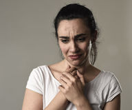 Beautiful and sad woman crying desperate and depressed with tears on her eyes suffering pain. Beautiful face of sad woman crying desperate and depressed with Royalty Free Stock Images