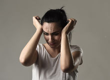 Beautiful and sad woman crying desperate and depressed with tears on her eyes suffering pain. Beautiful face of sad woman crying desperate and depressed with Royalty Free Stock Image