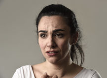 Beautiful and sad woman crying desperate and depressed with tears on her eyes suffering pain. Beautiful face of sad woman crying desperate and depressed with Stock Photo