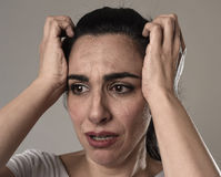 Beautiful and sad woman crying desperate and depressed with tears on her eyes suffering pain. Beautiful face of sad woman crying desperate and depressed with Royalty Free Stock Photos