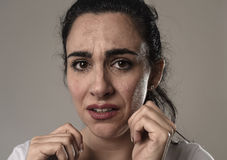 Beautiful and sad woman crying desperate and depressed with tears on her eyes suffering pain. Beautiful face of sad woman crying desperate and depressed with Stock Photos
