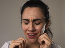 Beautiful and sad woman crying desperate and depressed with tears on her eyes suffering pain Royalty Free Stock Photo