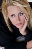 Beautiful But Sad Young Blond Woman With Blue Eyes Royalty Free Stock Images