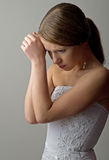 Beautiful sad young woman. On a gray background royalty free stock image