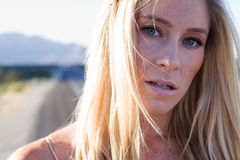 Beautiful Sadness. Beautiful blonde in the desert in the sun Royalty Free Stock Photo