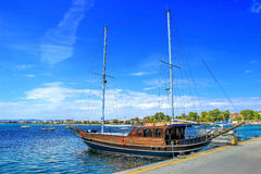 Beautiful sailboat on blue sea. Beautiful wooden sailboat on blue sea ocean Stock Photography