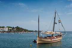 Beautiful sailboat moored near the coast. CADAQUES - Spain - 16 August 2017 - Beautiful sailboat moored near the coast Stock Images