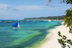 Beautiful sailboat near white sand beach in Boracay Stock Images