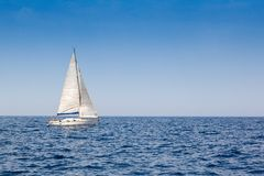 Beautiful sailboat with a white sail Royalty Free Stock Images