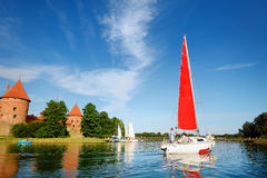 Beautiful sailbout on a lake by Trakai castle Royalty Free Stock Photos