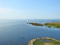 Beautiful sailing ship in Curonian spit, Lithuania stock photo