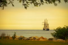 Beautiful sailing ship on sea at dusk Royalty Free Stock Photography