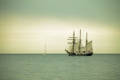 Beautiful sailing ship on sea at dusk Royalty Free Stock Photos