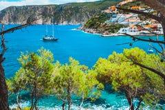 Free Beautiful Sailing Yacht Near Picturesque Seacoast. Assos Village Mediterranean Sea, Greece. Summer Vacation On Greek Stock Photos - 124639173