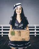 Beautiful sailor girl holding military ammo box Stock Photos