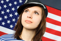 Beautiful sailor near the American flag Stock Photos