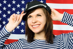 Beautiful sailor standing near the American flag Stock Photos