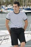 Beautiful sailorman wearing sailor clothes in a ya Stock Photos